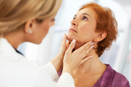 woman undergoing thyroid exam