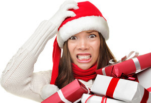 stressed out woman with santa hat