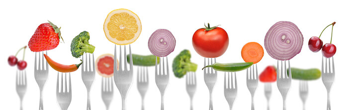 healthy fruits and veggies on a fork