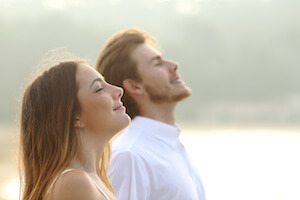 Man and woman breathing