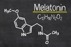 Melatonin chemical properties written on a chalkboard